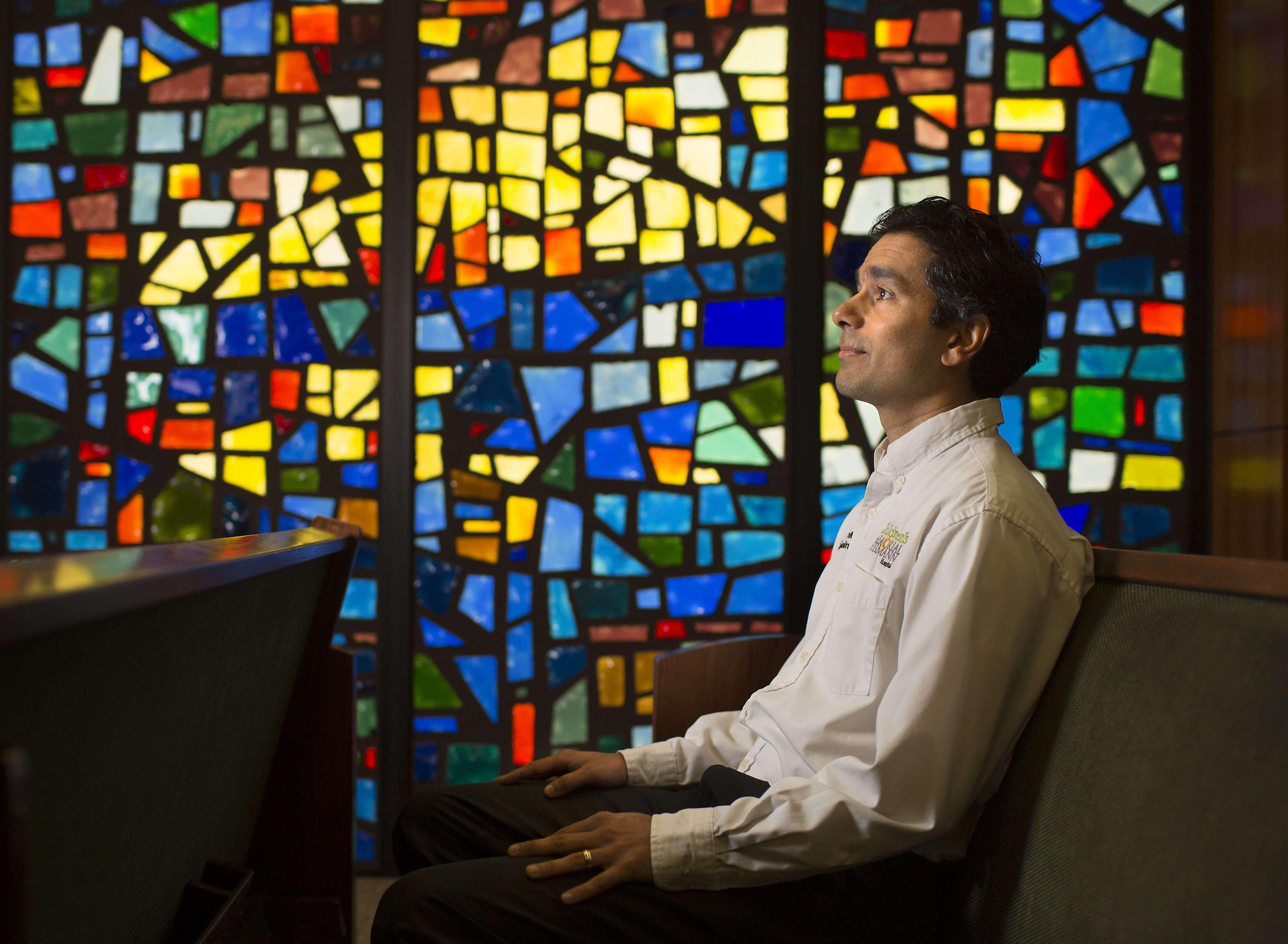 Joel Blest, a pediatric chaplain, in the chapel at Children's Memorial Hermann Hospital.