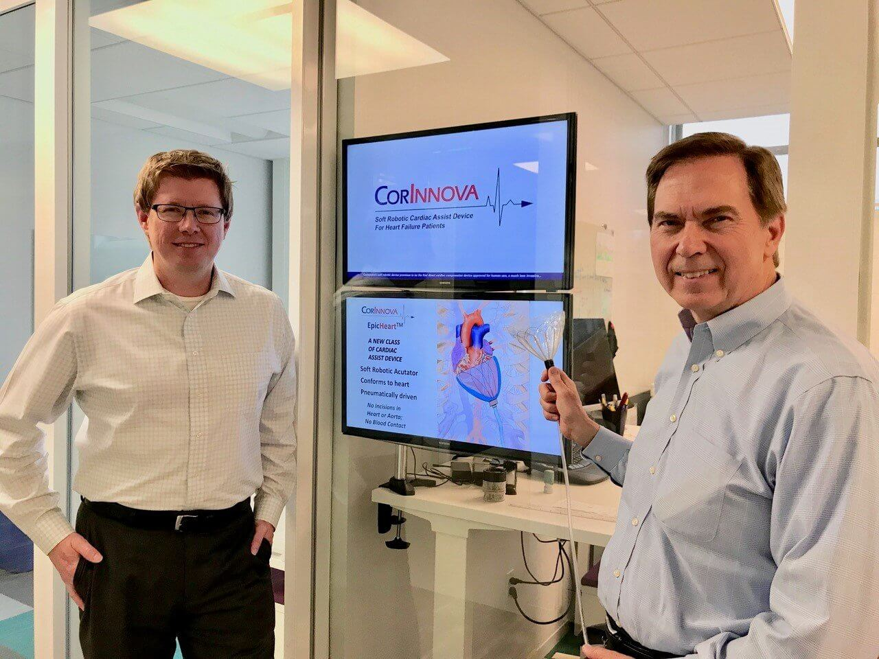 William Altman, CEO, (right) and Keith Svagerko, VP of Business Development (left) shown with latest prototype of CorInnova EpicHeart device at CorInnova's office at JLABS @ TMC in the Texas Medical Center.