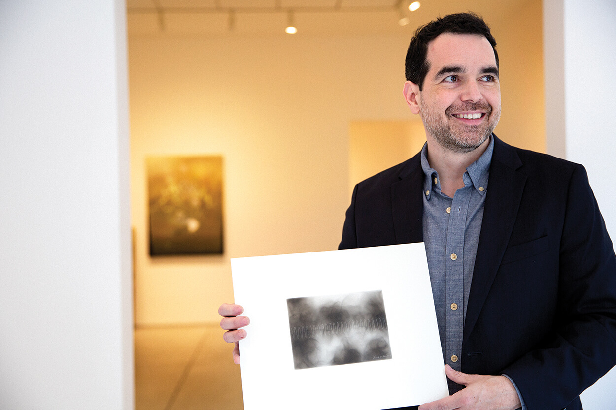 Robleto holds one of his prints at Inman Gallery.