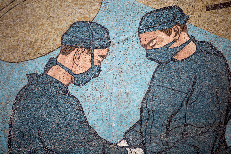 The mosaic highlights advances in modern medicine.