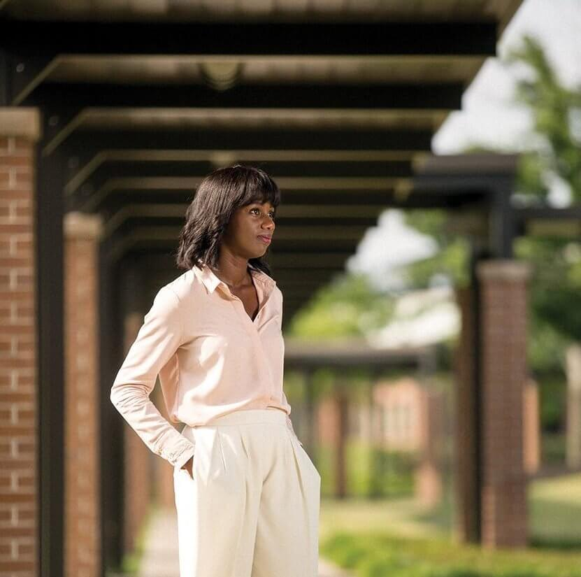 Kula Moore, a psychiatric rehabilitation specialist at The Menninger Clinic and a board-certified art therapist, poses on The Menninger Clinic campus.