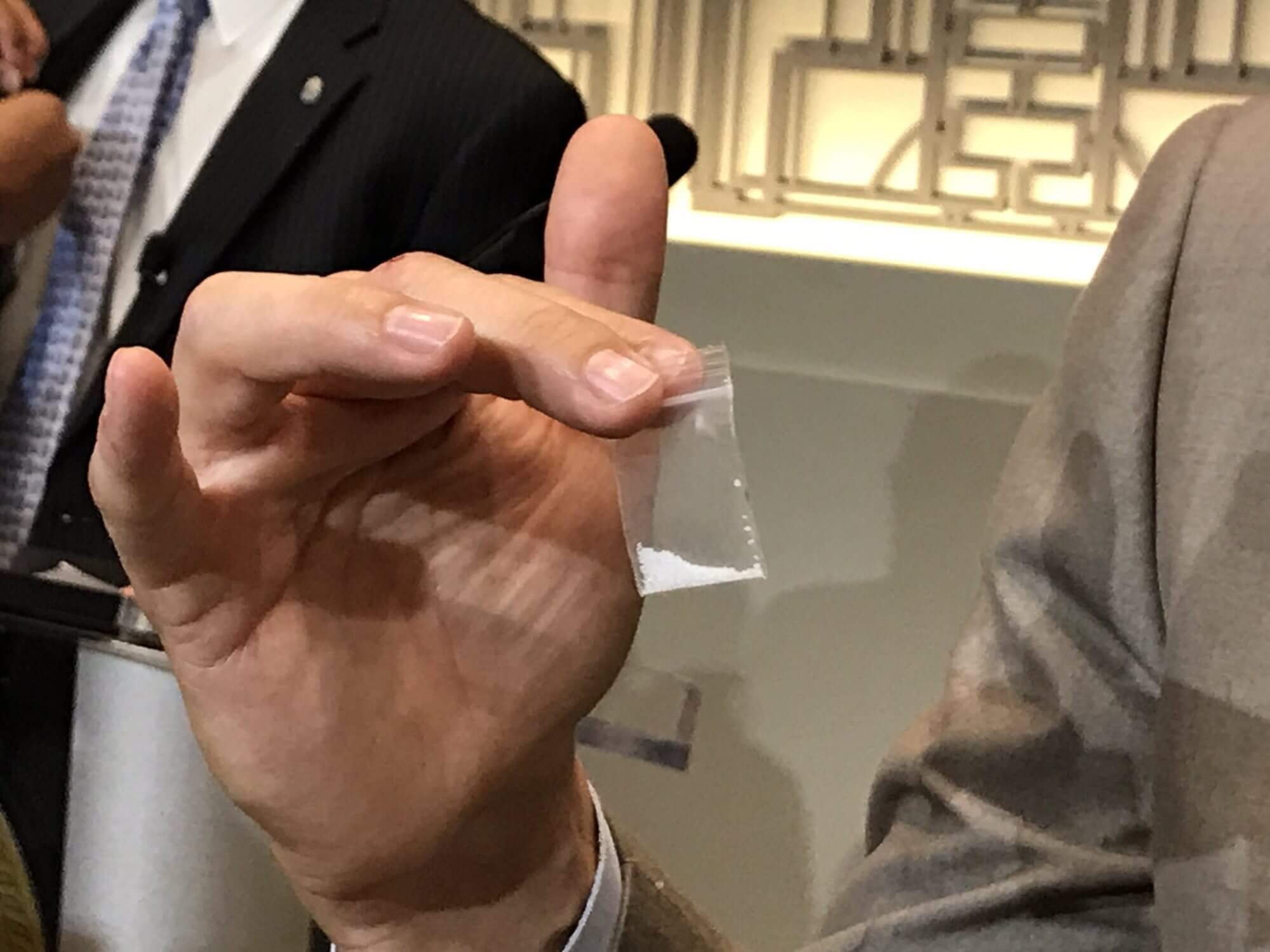 During a press conference, Peter Stout, Ph.D., of the Houston Forensic Science Center, holds bag of sugar representing the amount of carfentanil that could be lethal to up to 4,000 people. (Twitter/Mel Ragsdale Darragh)