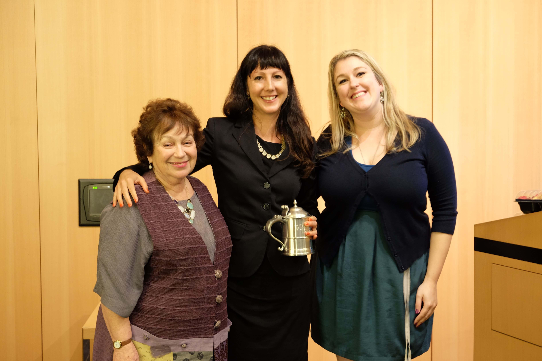 Amy Maxmen, Ph.D., with David Bricker's mother, Karin Bricker, left, and wife, Deanna Oleske, M.D., right. (Photo credit: Doris Huang, Houston Methodist)