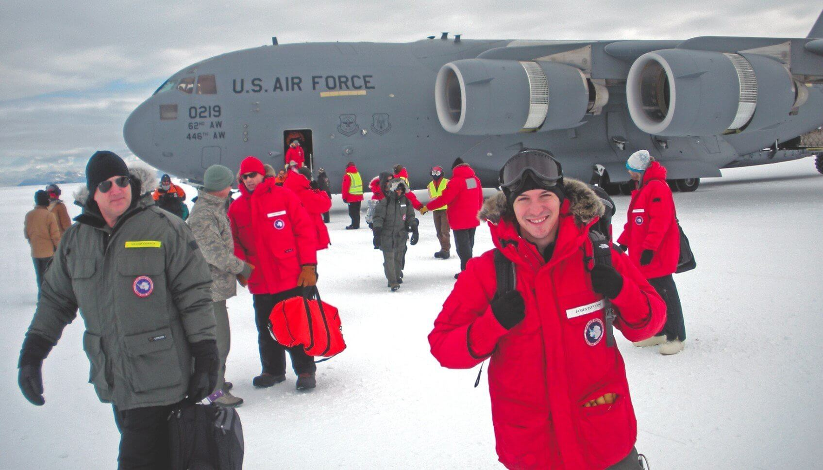James Pattarini, M.D., MPH (right) originally from Buffalo, New York, doesn't seem too deterred by the cold after touching down in Antarctica. (Photo provided by James Pattarini)