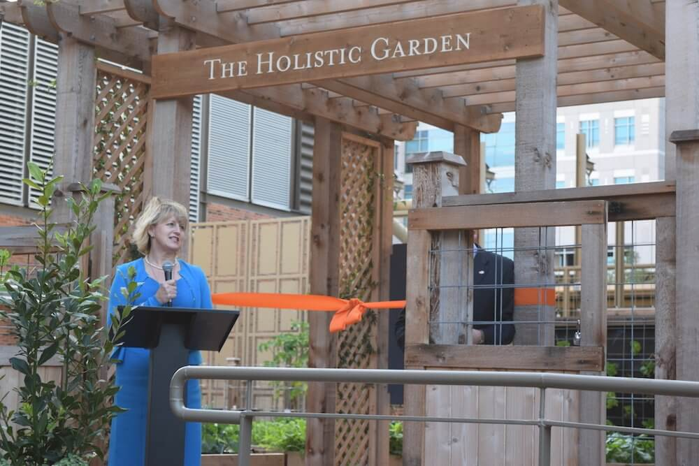 Deanna Hoelscher, director of the Michael and Susan Dell Center for Healthy Living at UTHealth School of Public Health, speaks at the unveiling.