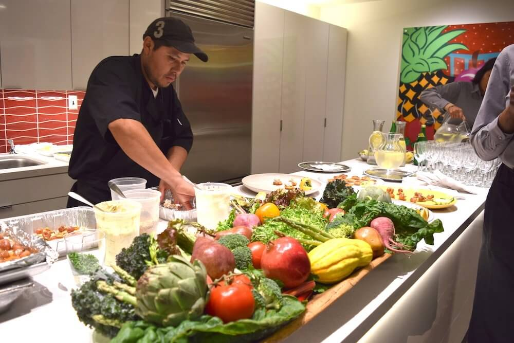 A chef prepares food in the UTHealth research and demonstration kitchen for the evening's reception.