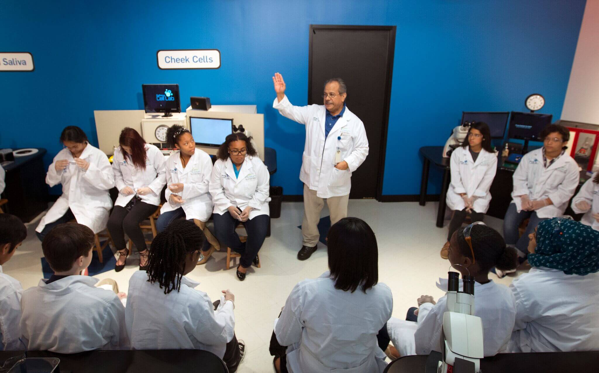 Gonzalo Perez, a DeBakey Cell Lab educator at the John P. McGovern Museum of Health and Medical Science, instructs students with the Faces of Innovation: Global Teen Medical Summit, how to perform the laboratory experiments.