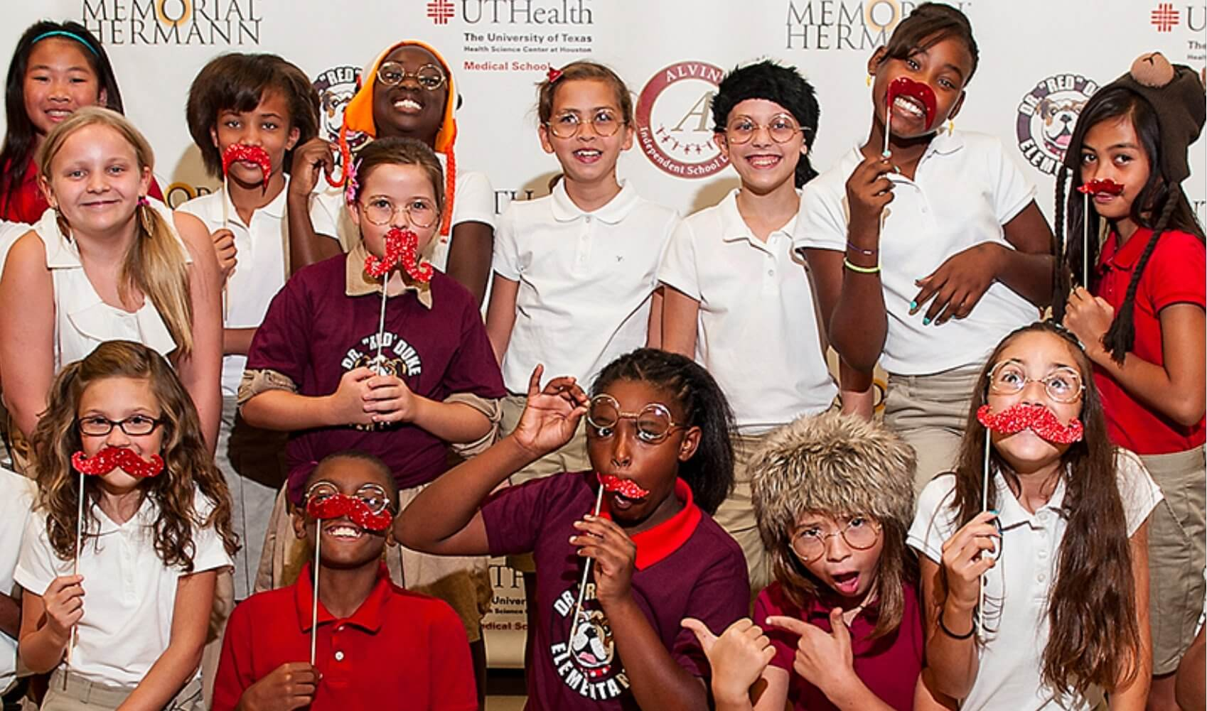 Students wear red mustaches in a playful nod to Duke (Credit: Memorial Hermann-TMC)