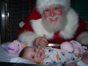 Santa Claus visits Ellie in the cardiovascular intensive care unit in Texas Children's Hospital (Photo courtesy of Andrew and Dana Ferraro)
