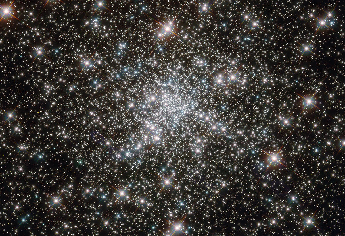 Young stars at home in ancient cluster. (Credit: NASA)