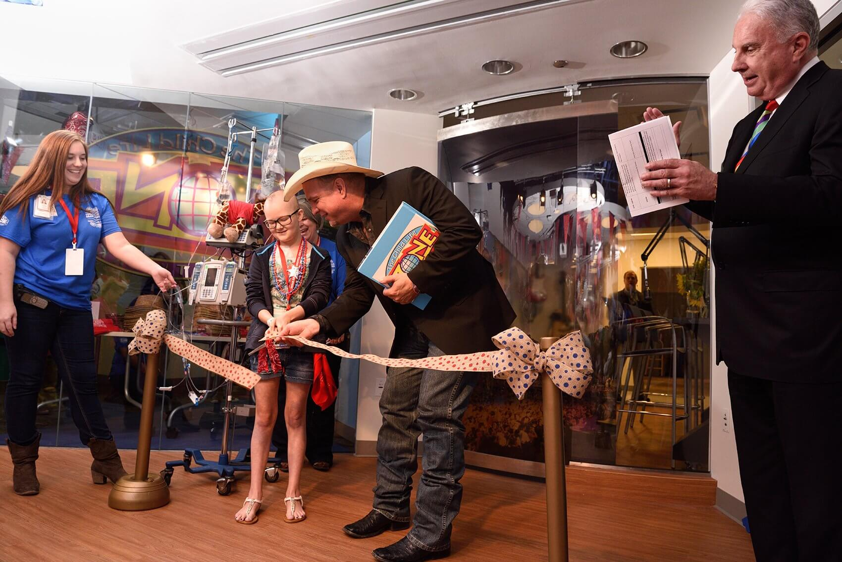 More than 100 patients and their families attended the grand opening of the newly renovated and expanded Child Life Zone at Texas Children's Hospital in Houston and were given the chance to meet Garth Brooks. (Credit: Paul Vincent Kuntz, Texas Children's Hospital)