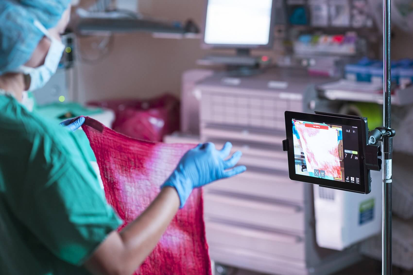 Using the iPad camera, the Triton System scans surgical sponges containing blood and sends the images to the cloud server for processing.