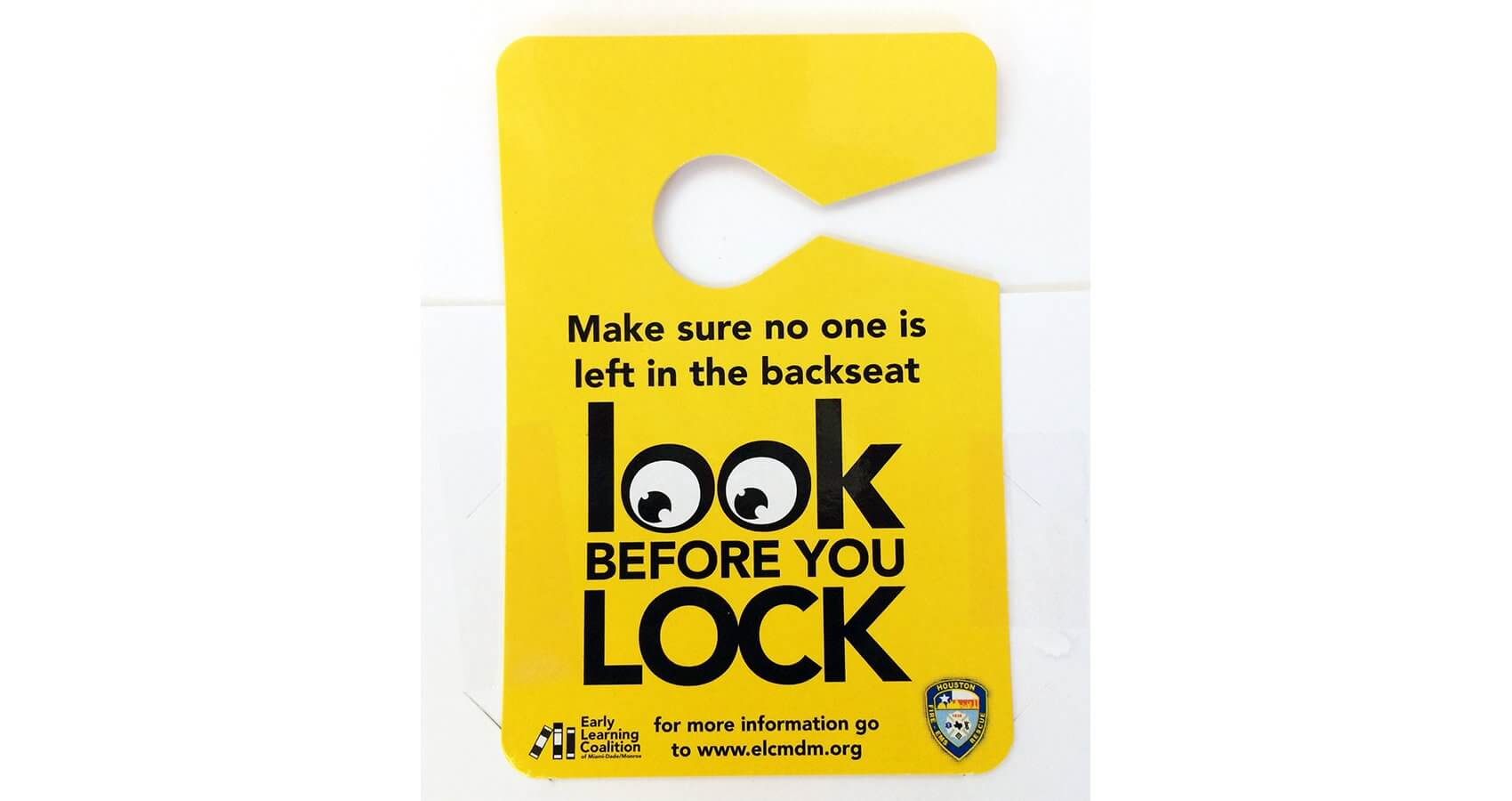 Tags from the Houston Fire Department remind drivers to check the backseat before locking their vehicle.