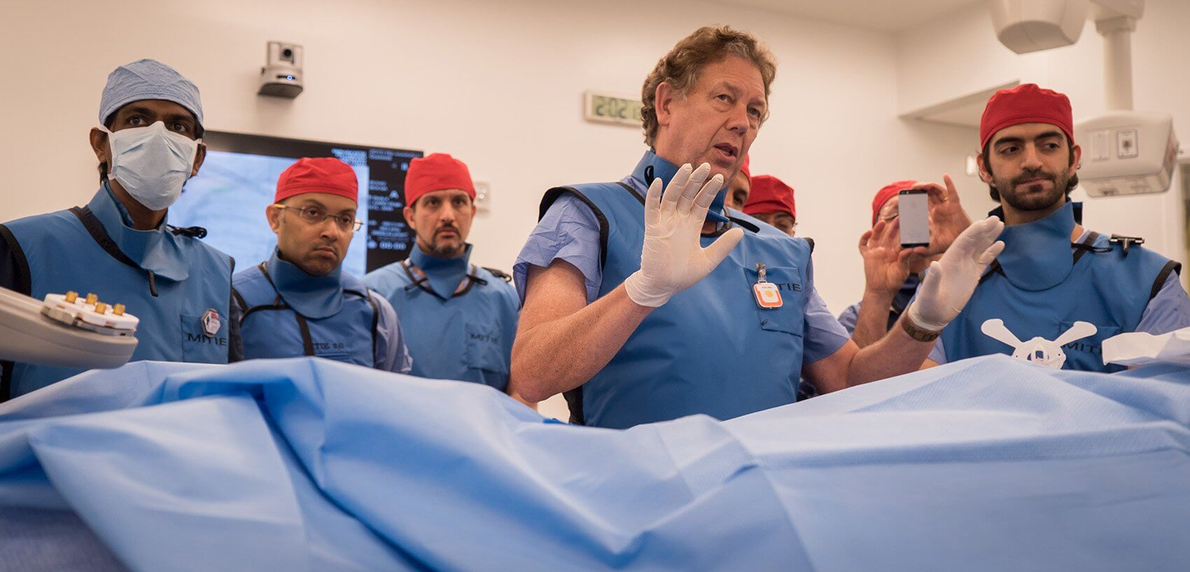 Alan B. Lumsden, M.D., demonstrates a rotational fluoroscopic CT machine used to create 3D images.