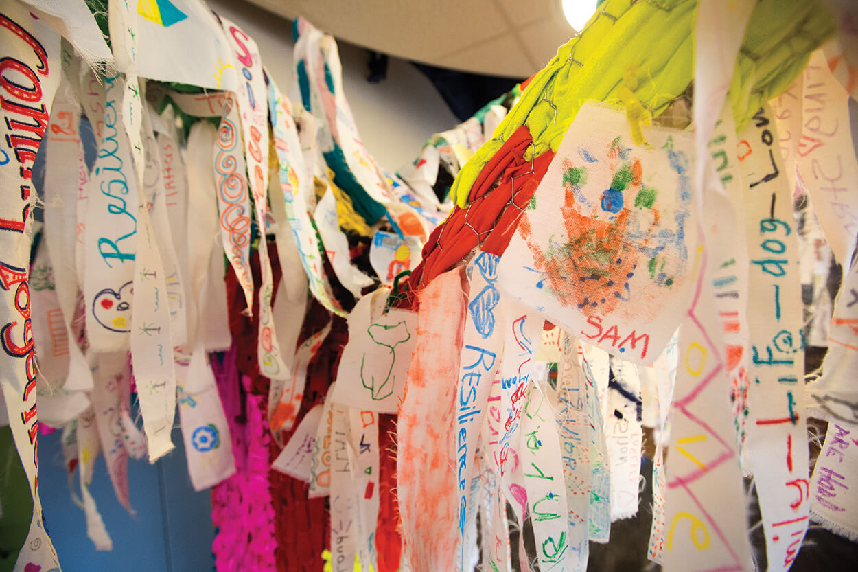 Colorful strips made by Harvey Healing Days participants create the leafy branches of the Harvey Healing Tree.