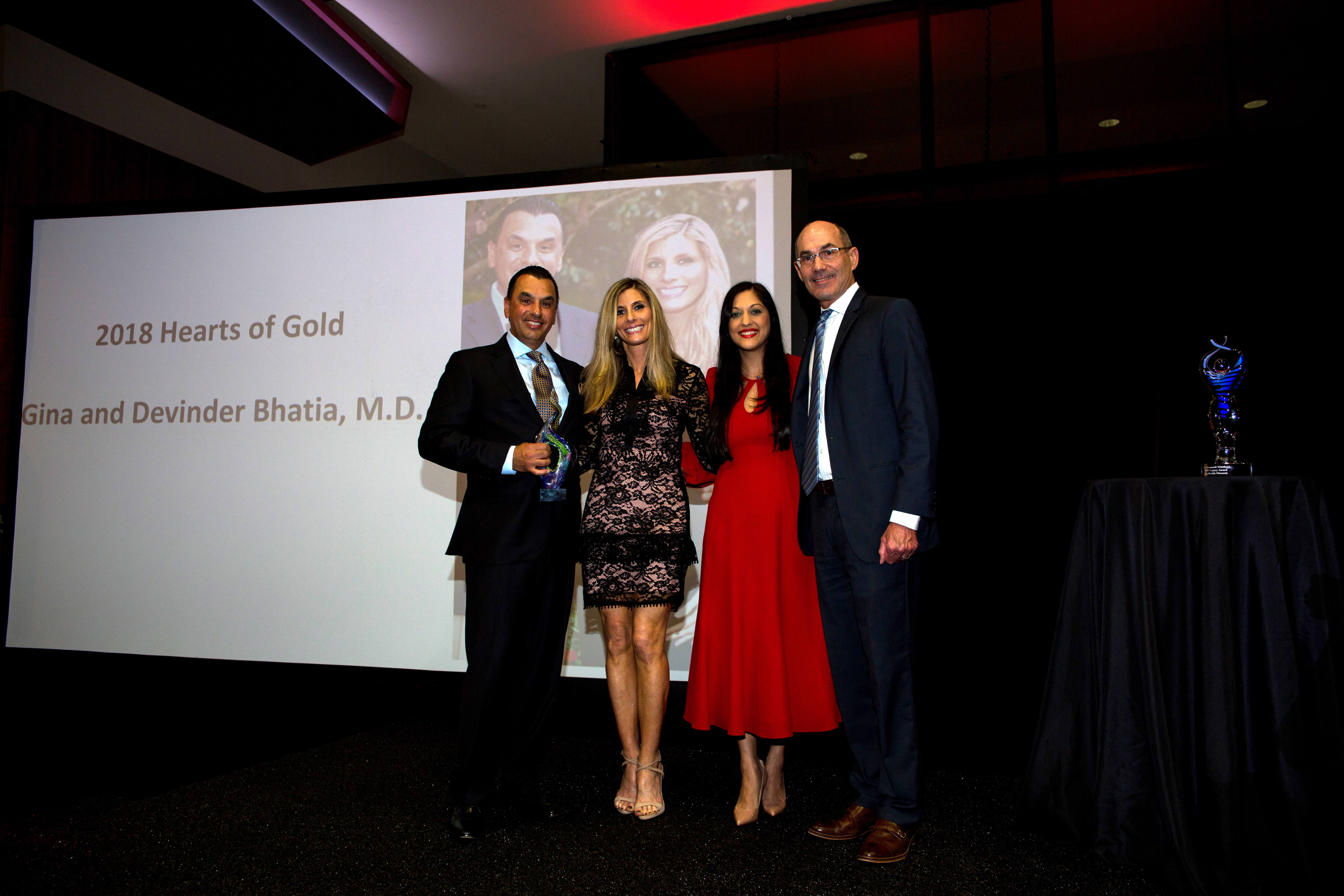 Philanthropists Gina Bhatia and Houston Methodist heart surgeon Devinder Bhatia, M.D., left, were presented with the 2018 Hearts of Gold Award.
