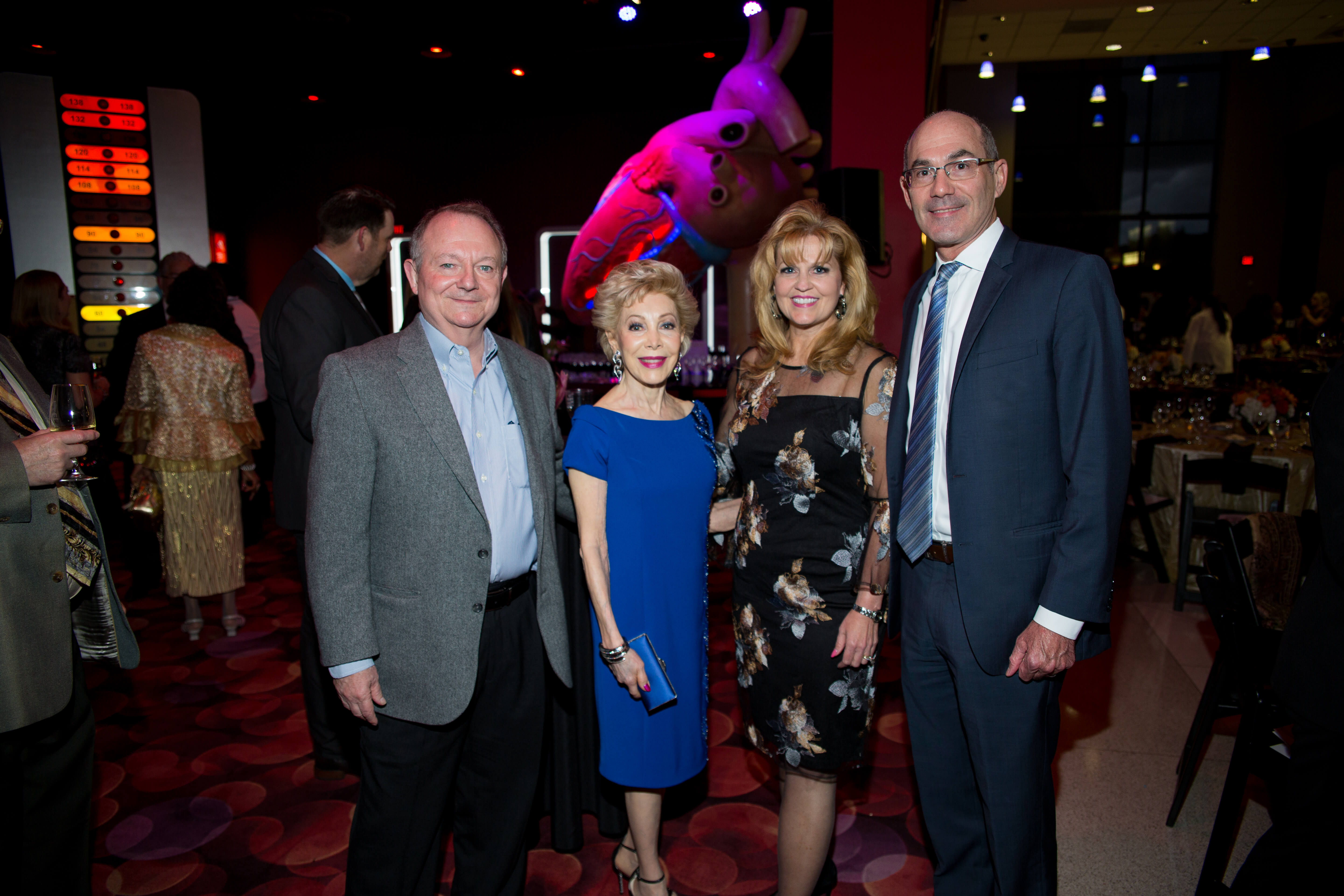 Houston philanthropist Margaret Alkek Williams, second from left, with John Arcidiacono, right, president and CEO of The Health Museum.