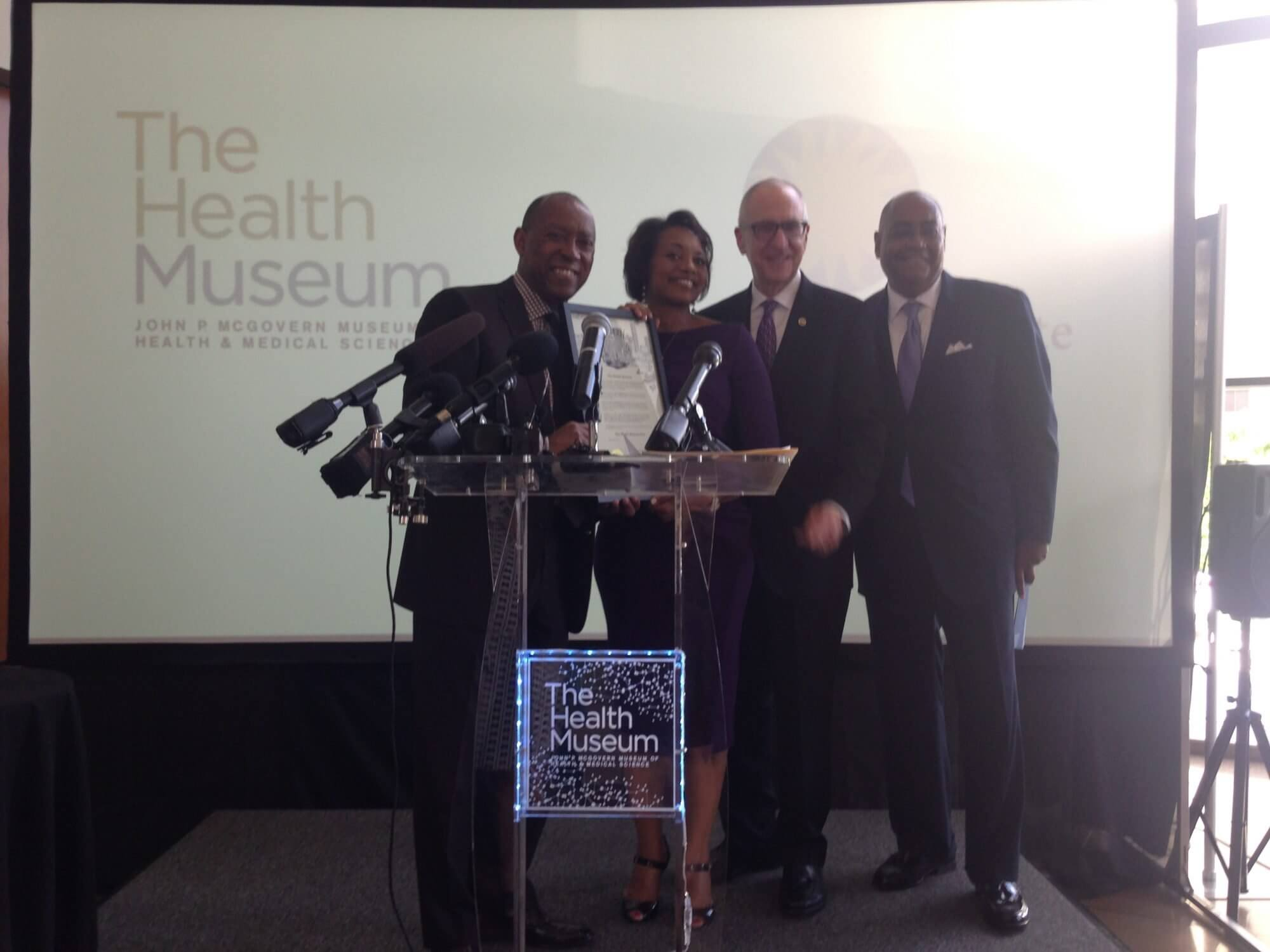 Posing onstage at The Health Museum, Houston Mayor Sylvester Turner; President and CEO of The Health Museum Melanie Johnson, Ed.D.; Smithsonian Secretary David Skorton; and Harris County Commissioner Rodney Ellis.