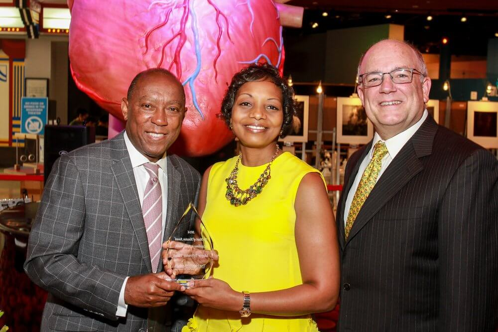 Mayor Tuner, The Health Museum President & CEO Melanie Johnson, Ed.D., and Board Chair Dr. Brian Parsley as Mayor Turner accepts Heart of Houston Health Award  Photography/Gary Fountain