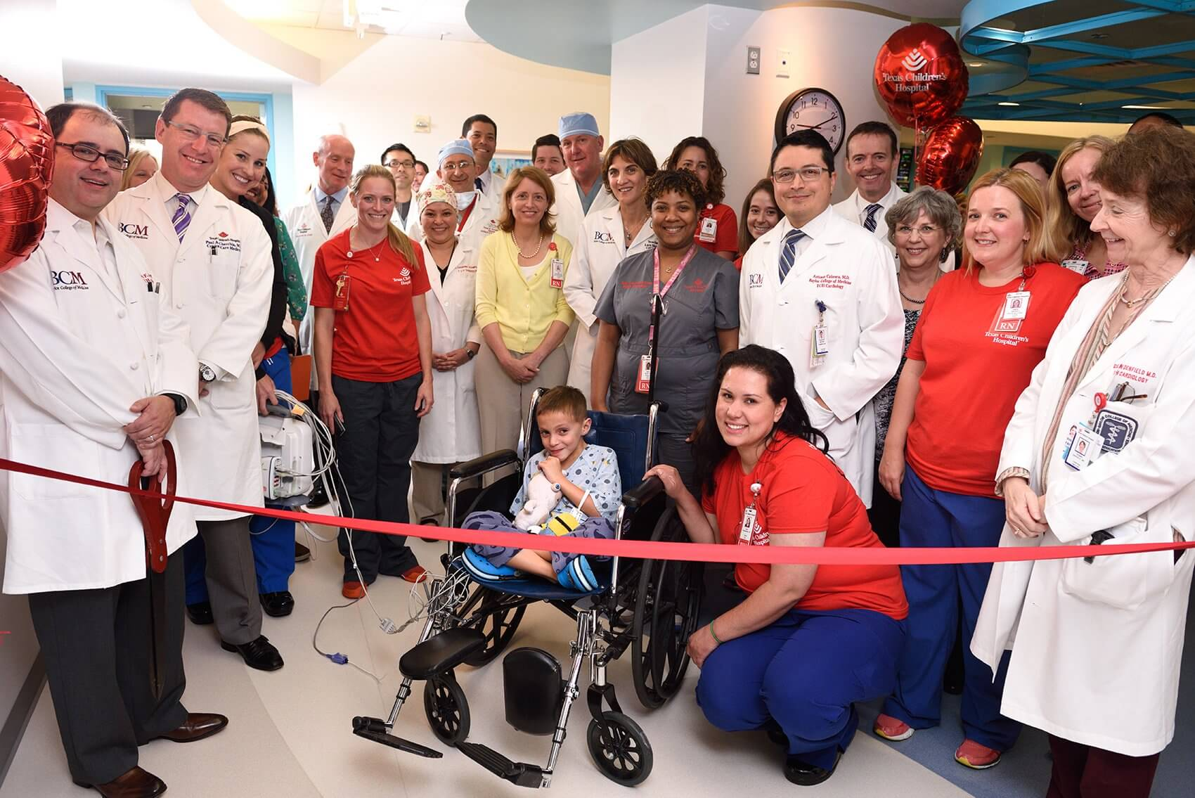 Patient Marcelo Perez and hospital leaders pose in front of the new Texas Children's Heart Failure Intensive Care Unit. (Credit: Paul Vincent Kuntz/Texas Children's Hospital)
