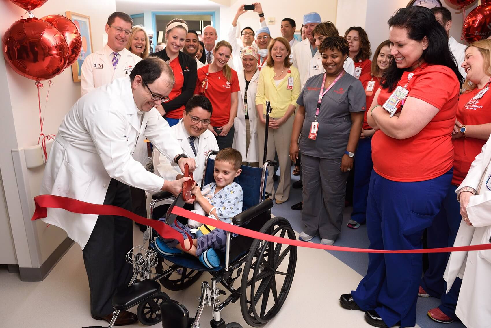 Perez and Drs. Antonio Cabrera and Jack Price cut the ribbon on the new unit. (Credit: Paul Vincent Kuntz/Texas Children's Hospital)
