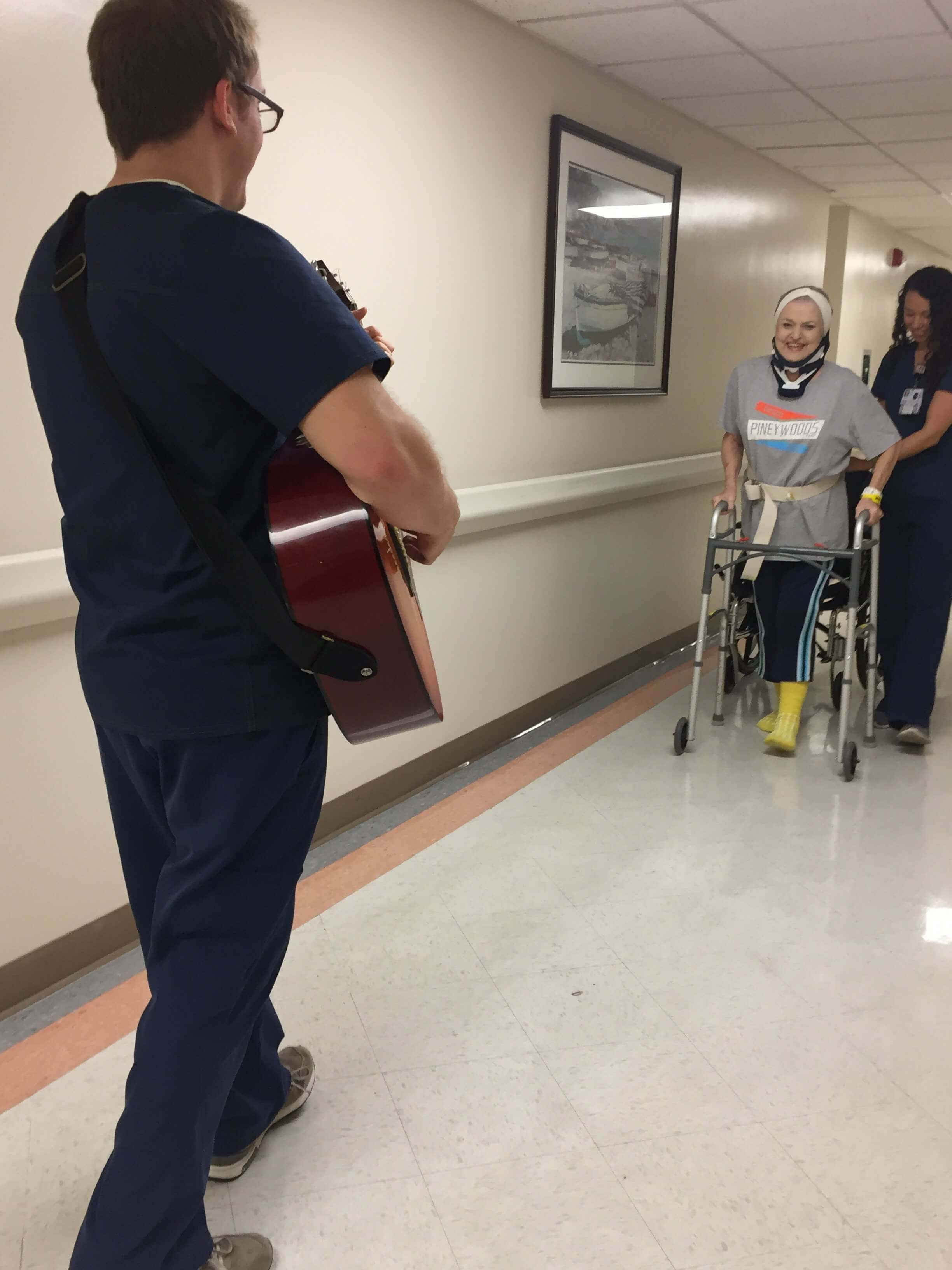 Music therapists work with a Houston Methodist patient using rhythmic auditory stimulation during gait training post spinal cord injury. (Photo Courtesy of Houston Methodist)