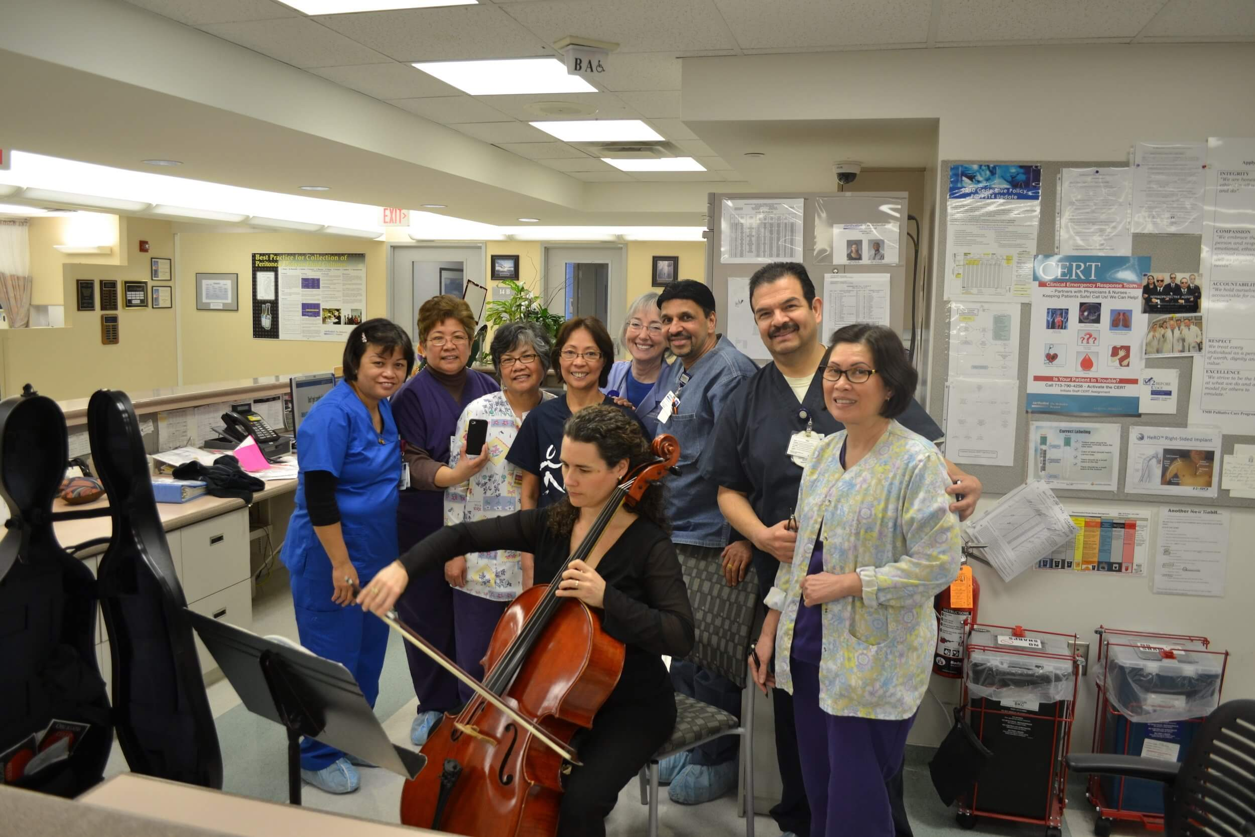 A visiting musician performs at a nursing station to support the environment of care for patients and staff. (Photo Courtesy of Houston Methodist)