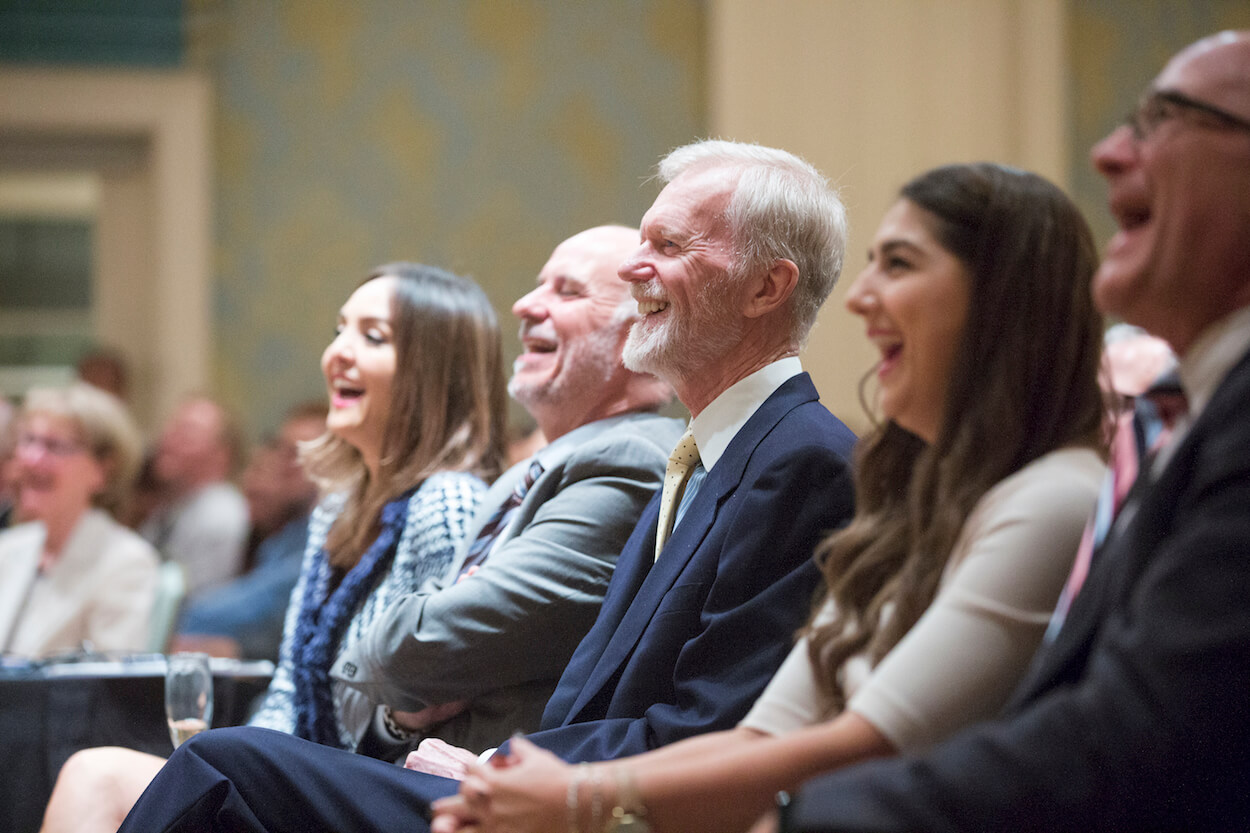 Former California Congressman Michael Huffington, son of Huffington Center on Aging namesakes Roy and Phyllis Huffington, reacts to his ex-wife's keynote address with guests.