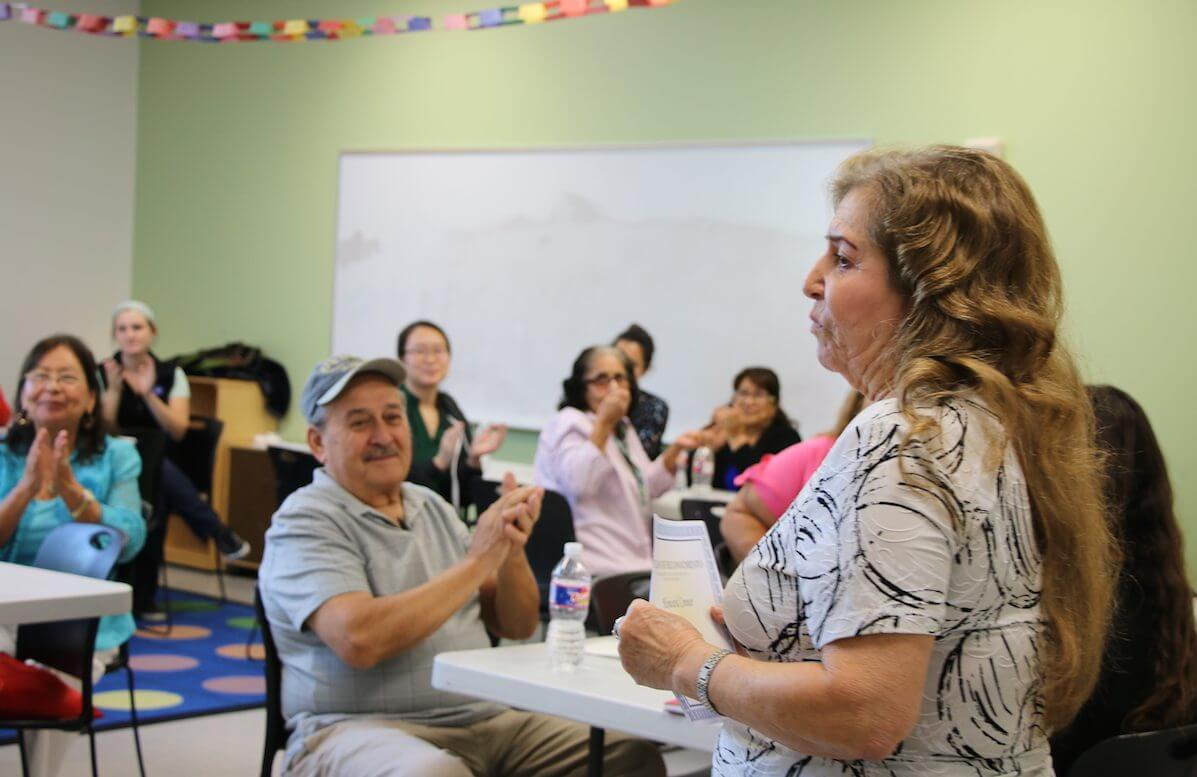 Guadalupe Quintanilla, Ed.D, speaks to Baylor PA students and their community partners during a fiesta luncheon on Friday, Aug. 3, celebrating the end of a two-week language immersion program. (Credit: Bethany Strother, Baylor College of Medicine)