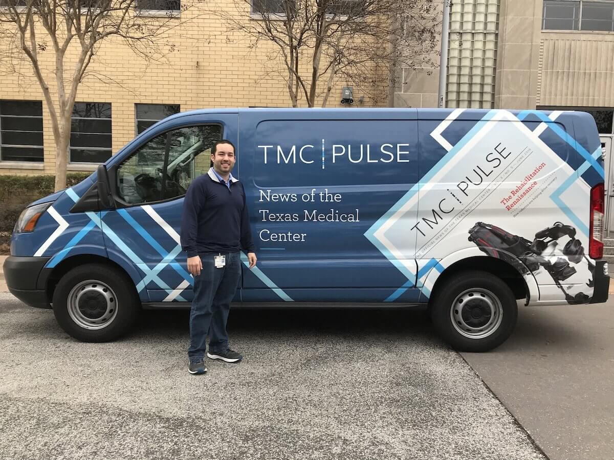 Daniel Martinez, who oversees the monthly distribution of TMC Pulse, stands beside the magazine's new delivery van.