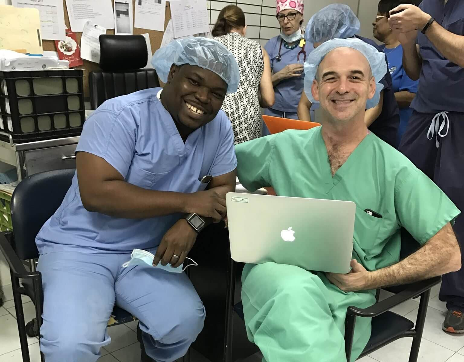 Yudy Lafortune, Dr. Sandberg's protege in Haiti, pictured with Dr. Sandberg at the Bernard Mevs Hospital.