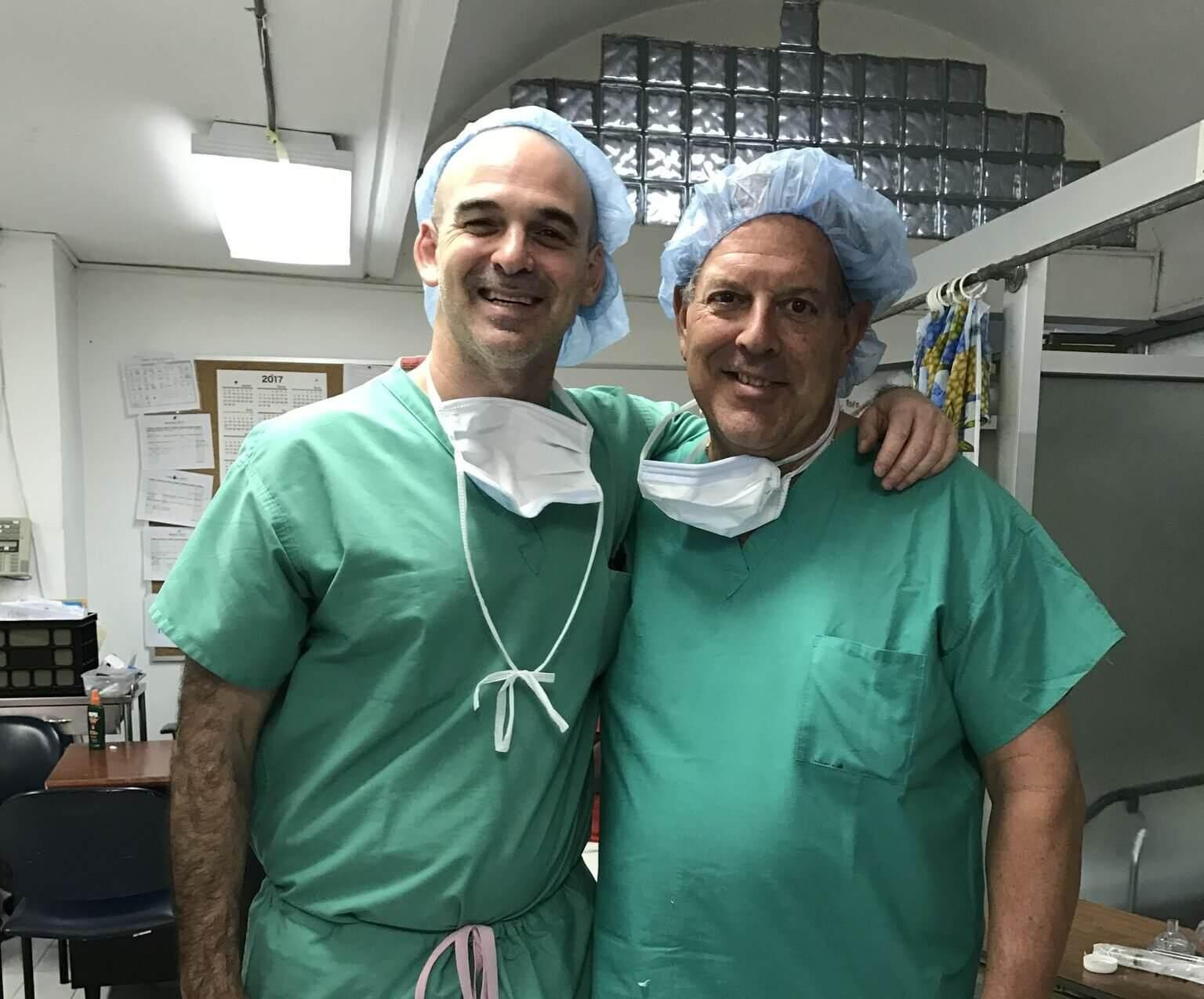 Sandberg and friend, Dick Bassett, at Bernard Mevs Hospital in Haiti, Jan. 2017.