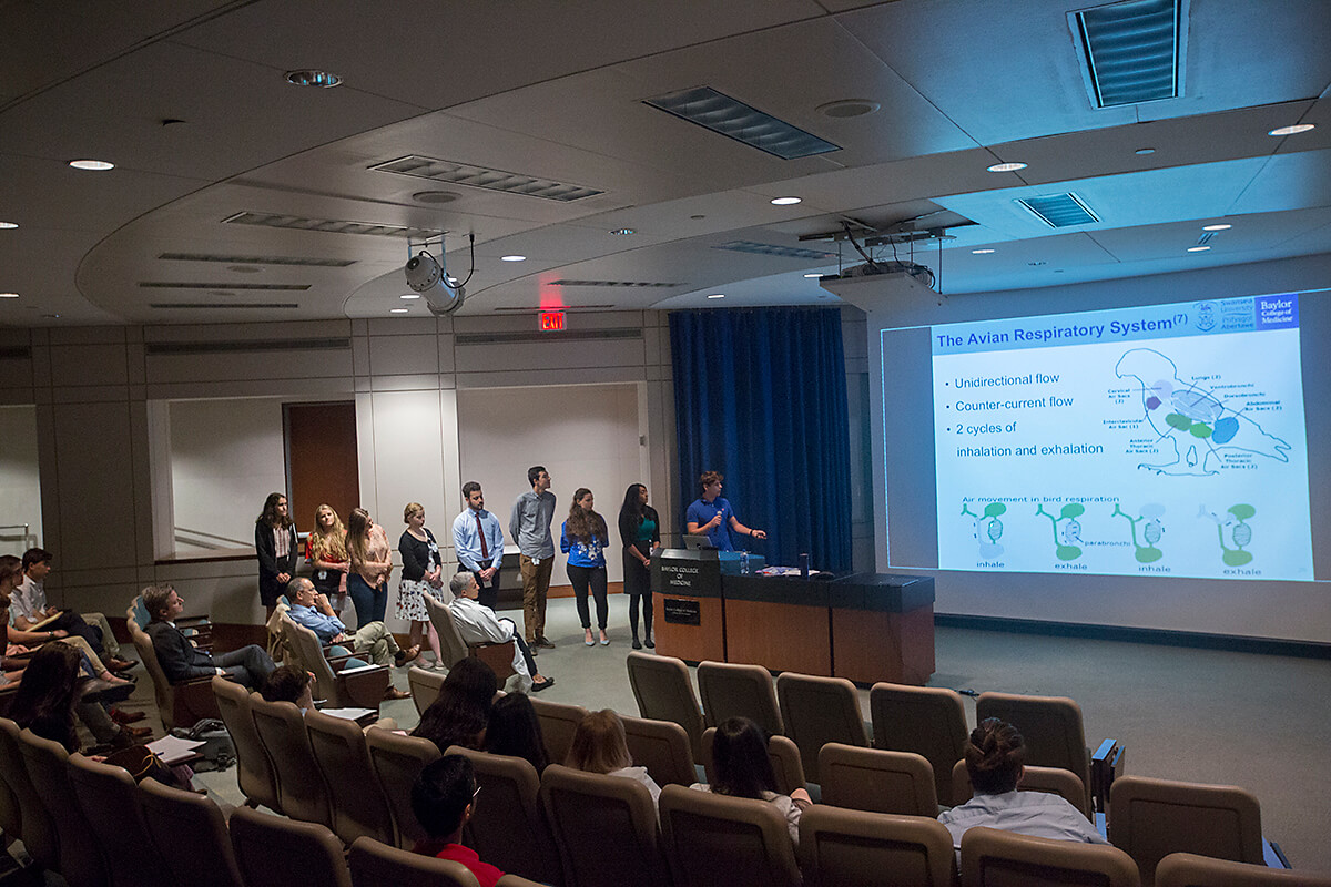 A group of nine students present 02-2U, a device the team created with Gabriel Loor, M.D., that could potentially eliminate the need for the ECMO machine.