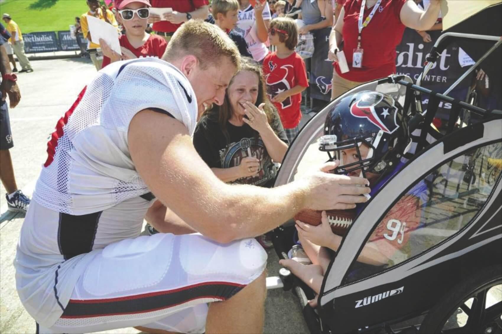 Izaiah meets Houston Texans defensive end J.J. Watt