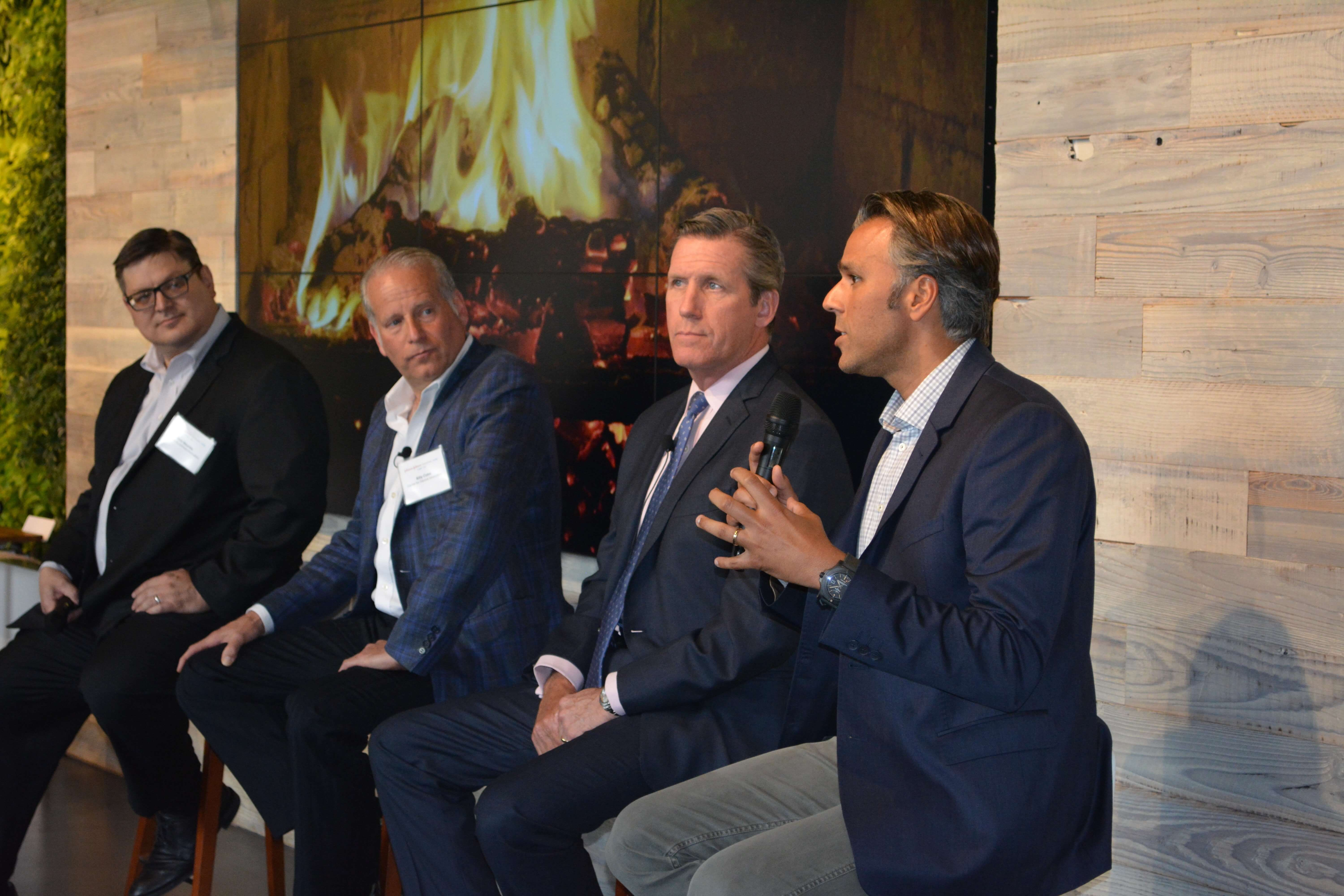 Arjun Desai, right, talks about medical devices with Johnson & Johnson's Mourlas and Cohn, and William McKeon, president and CEO of the Texas Medical Center.