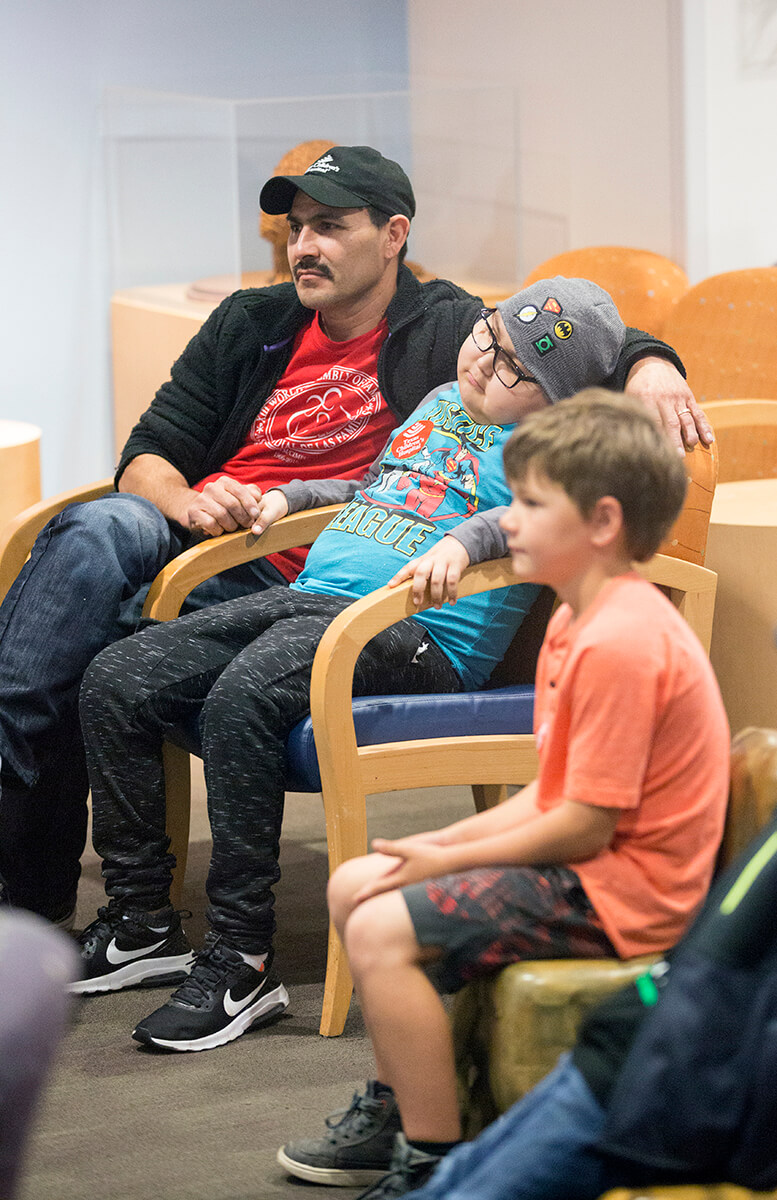 Leo Mosqueda and his father watch The Lion, the Witch and the Wardrobe at TCH.