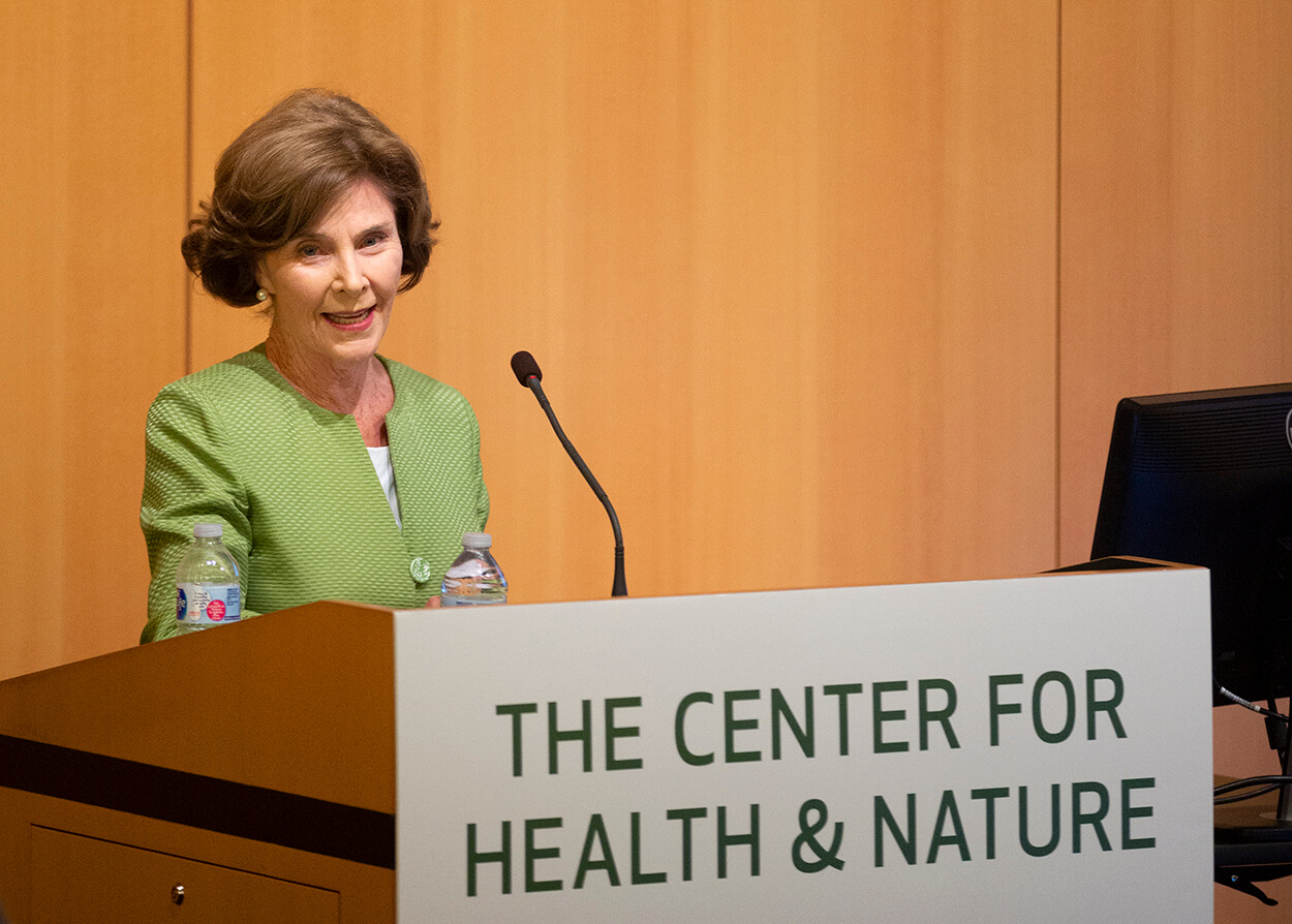 Former first lady Laura Bush speaks to the symposium audience about the benefits of nature to health.