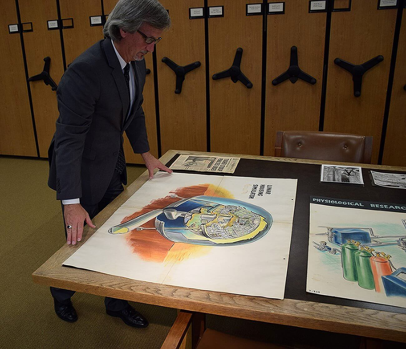 UTMB archivist Robert Marlin with items from the Berry Space Medicine Collection.