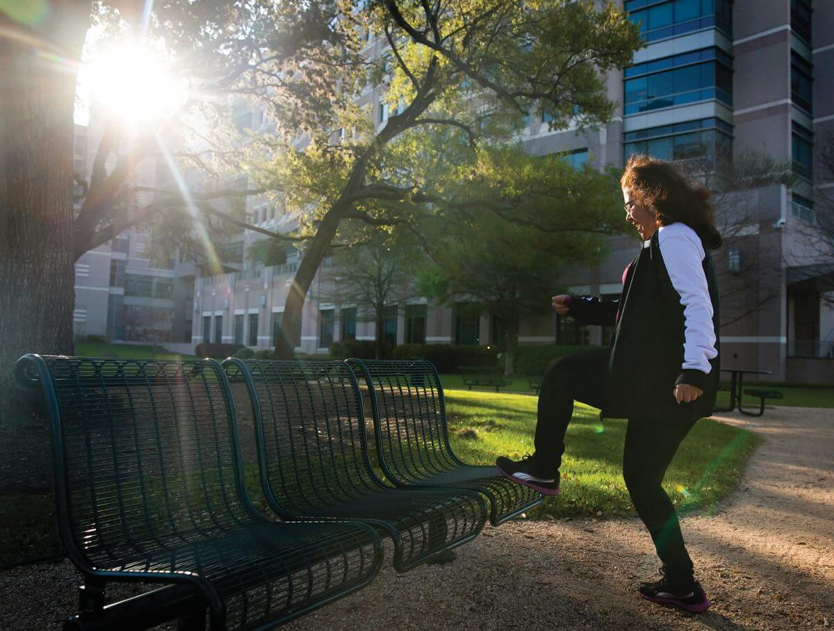 Yadira Peña, a two-time cancer survivor, prepares for a run around the MD Anderson Prairie in the Texas Medical Center.