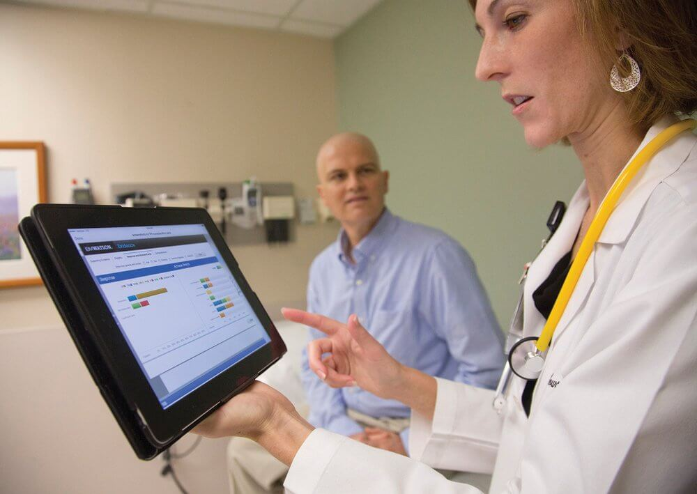 At The University of Texas MD Anderson Cancer Center, Assistant Professor of Leukemia Courtney DiNardo, M.D., uses IBM's Watson cognitive system while consulting with patients and colleagues. (Credit: Feature Photo Service)