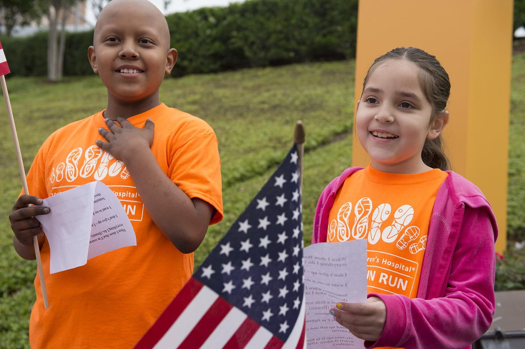 Dennis and Lauren, patients who are being treated at Texas Children's Hospital Cancer and Hematology Centers, read a poem about courage before the race began (Credit: Paul Vincent Kuntz/Texas Children's Hospital)