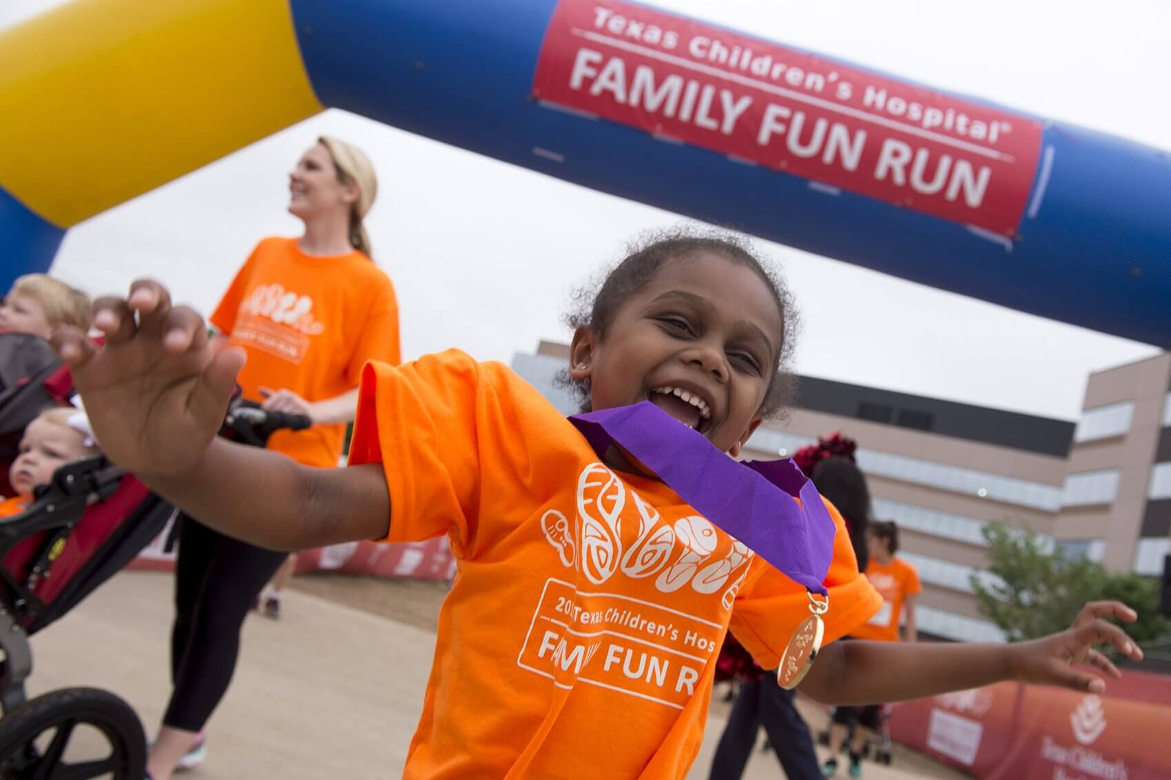 A young participant proudly shows off her medal after completing the race (Credit: Paul Vincent Kuntz/Texas Children's Hospital)