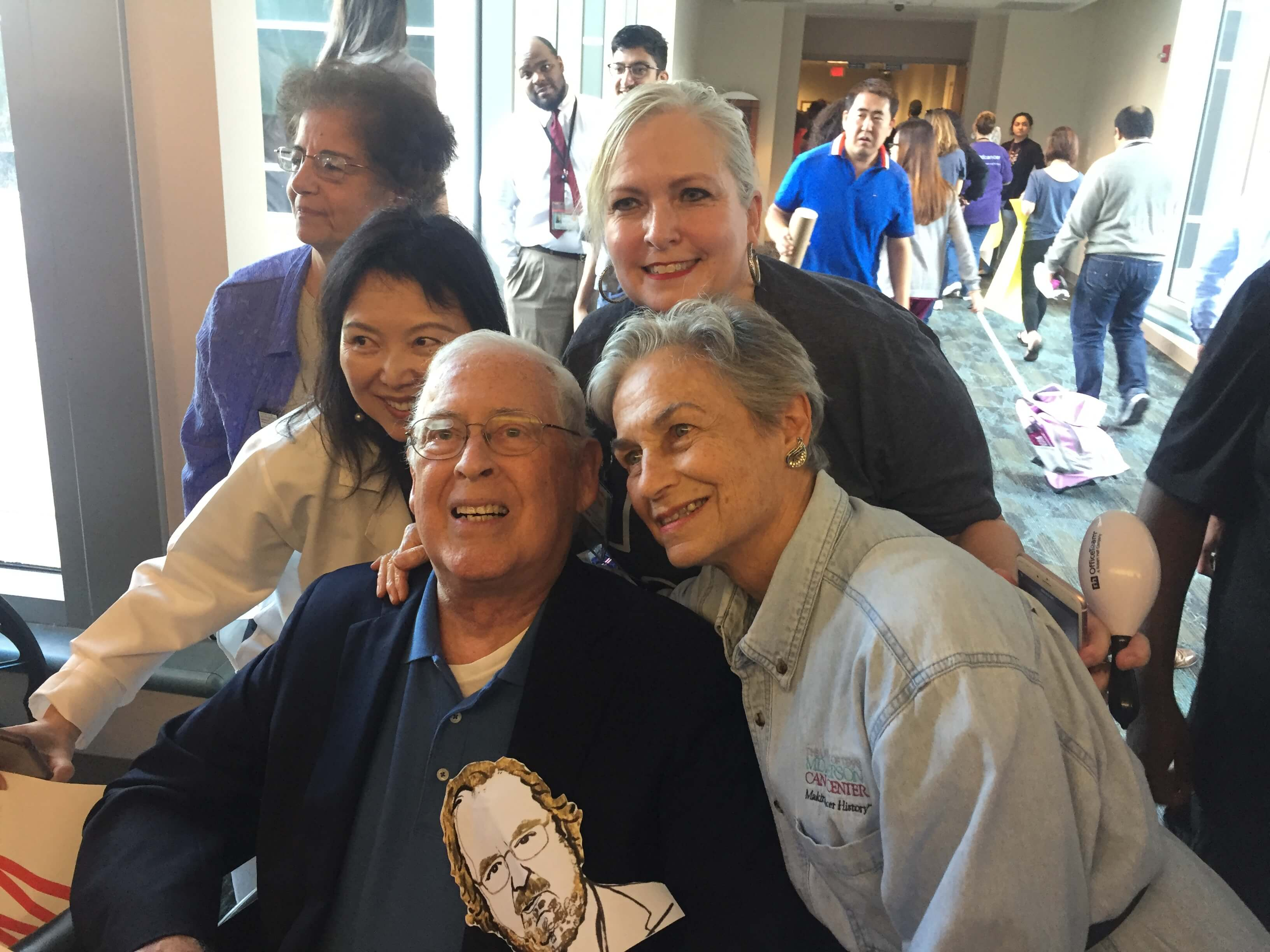 MD Anderson President Emeritus John Mendelsohn, his wife, Anne, right, and executive assistant Melissa Menchaca, center, celebrate on Oct. 5, 2018 during the parade through the cancer center to honor Nobel Prize laureate James Allison, Ph.D. (Photo by Cindy George)
