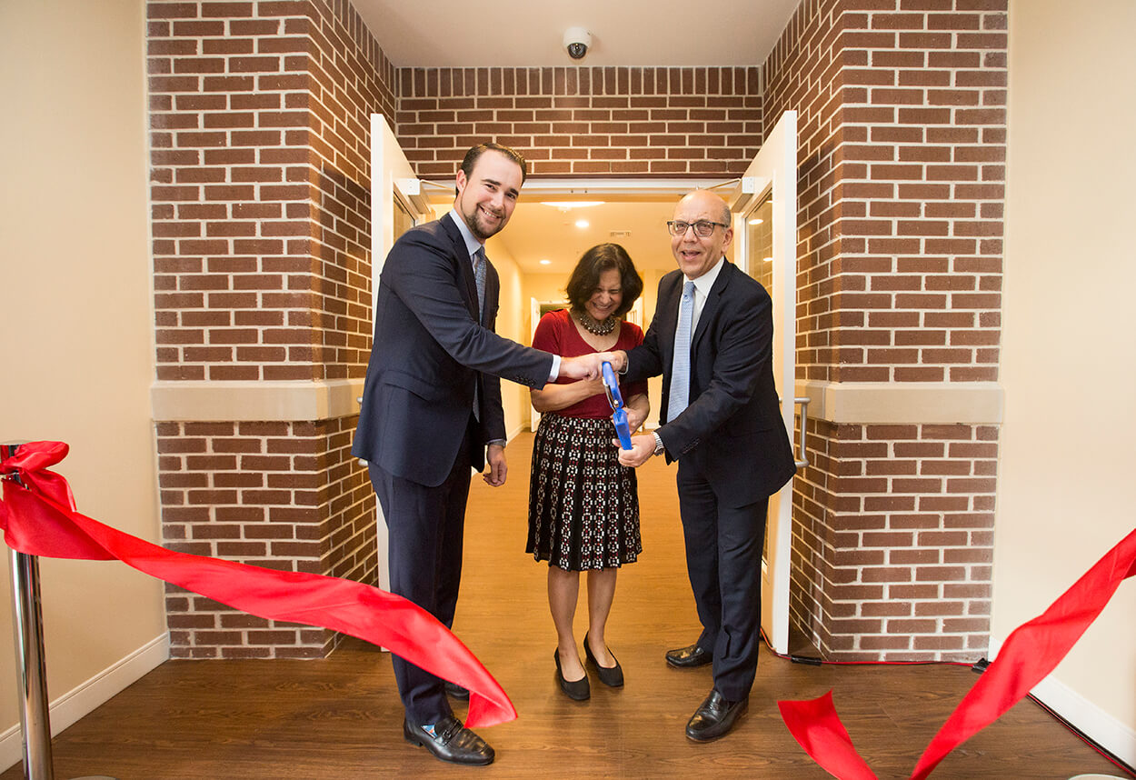 Shawn Cloonan, TMC COO, (left) assists Lillian Gaber, M.D., and Osama Gaber, M.D., in the ceremonial ribbon cutting of the expansion.