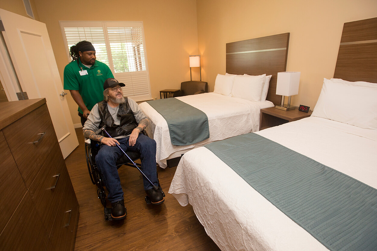 Nora's Home patient Mike Catlett tours the new rooms in the expansion.