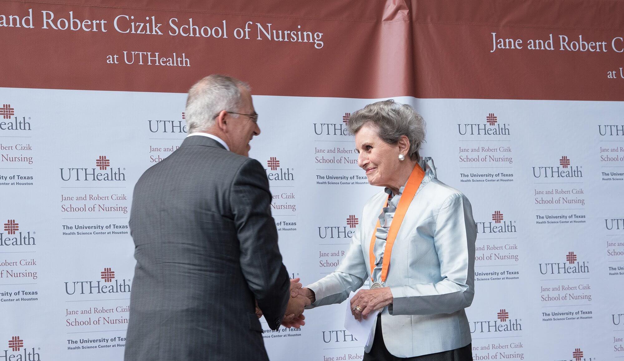 UTHealth President Giuseppe Colasurdo., M.D., and Jane Cizik after her remarks. Photo by Katy Umana, UTHealth.