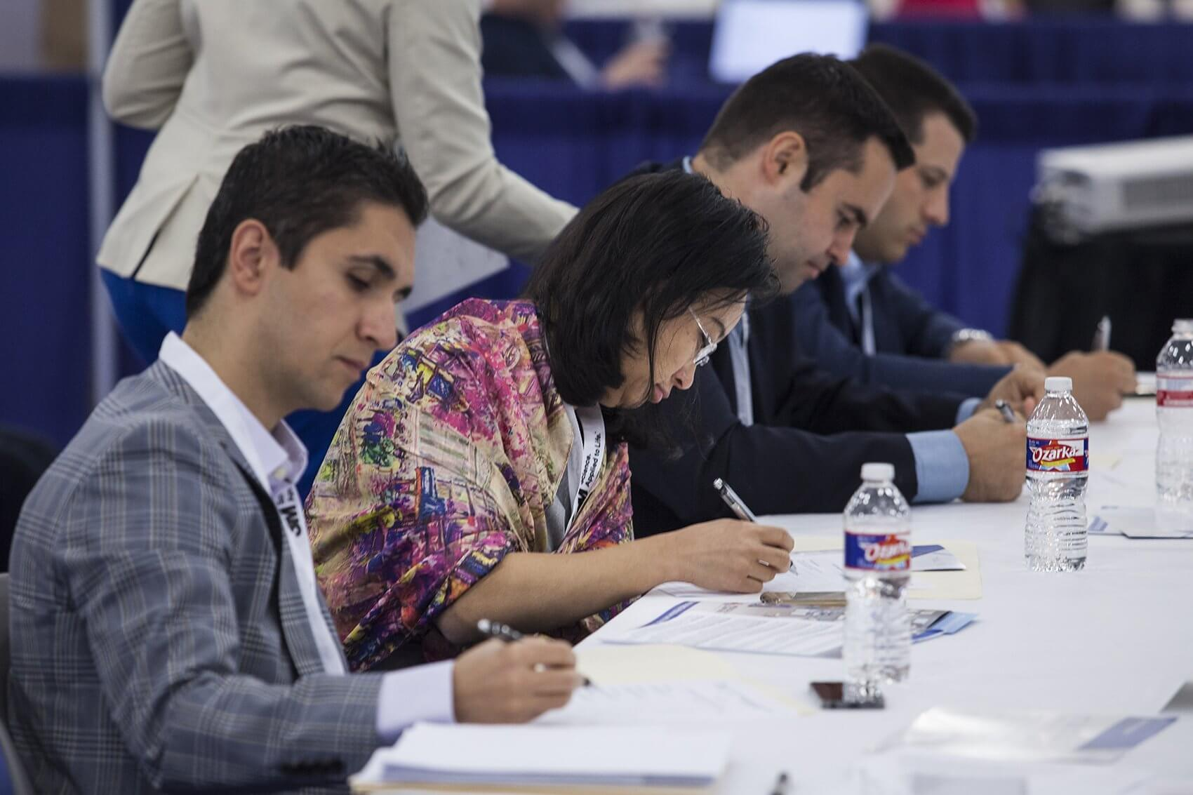 The judges—Farzard Soleimani, M.D., Lynda Chin, M.D., Eric Richardson, Ph.D. and Thomas DeSouza—make their selections.