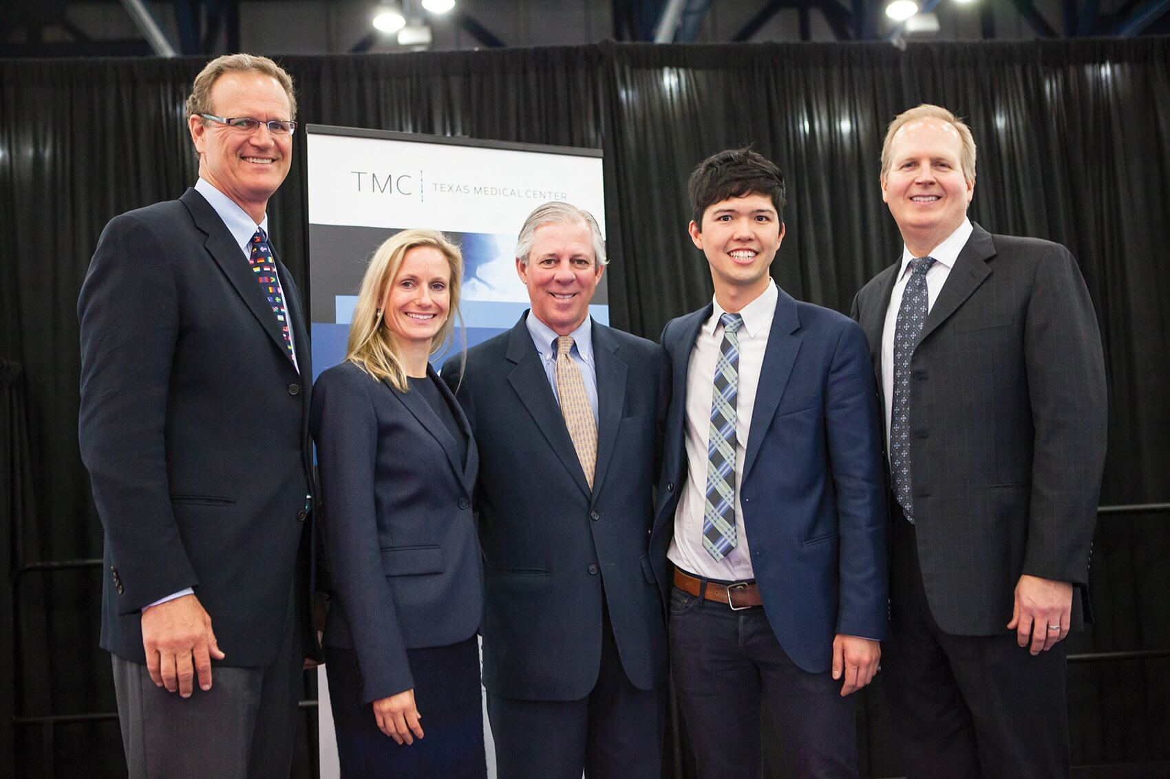 Winners of the TMCx pitch competition pose with Dr. Robbins.