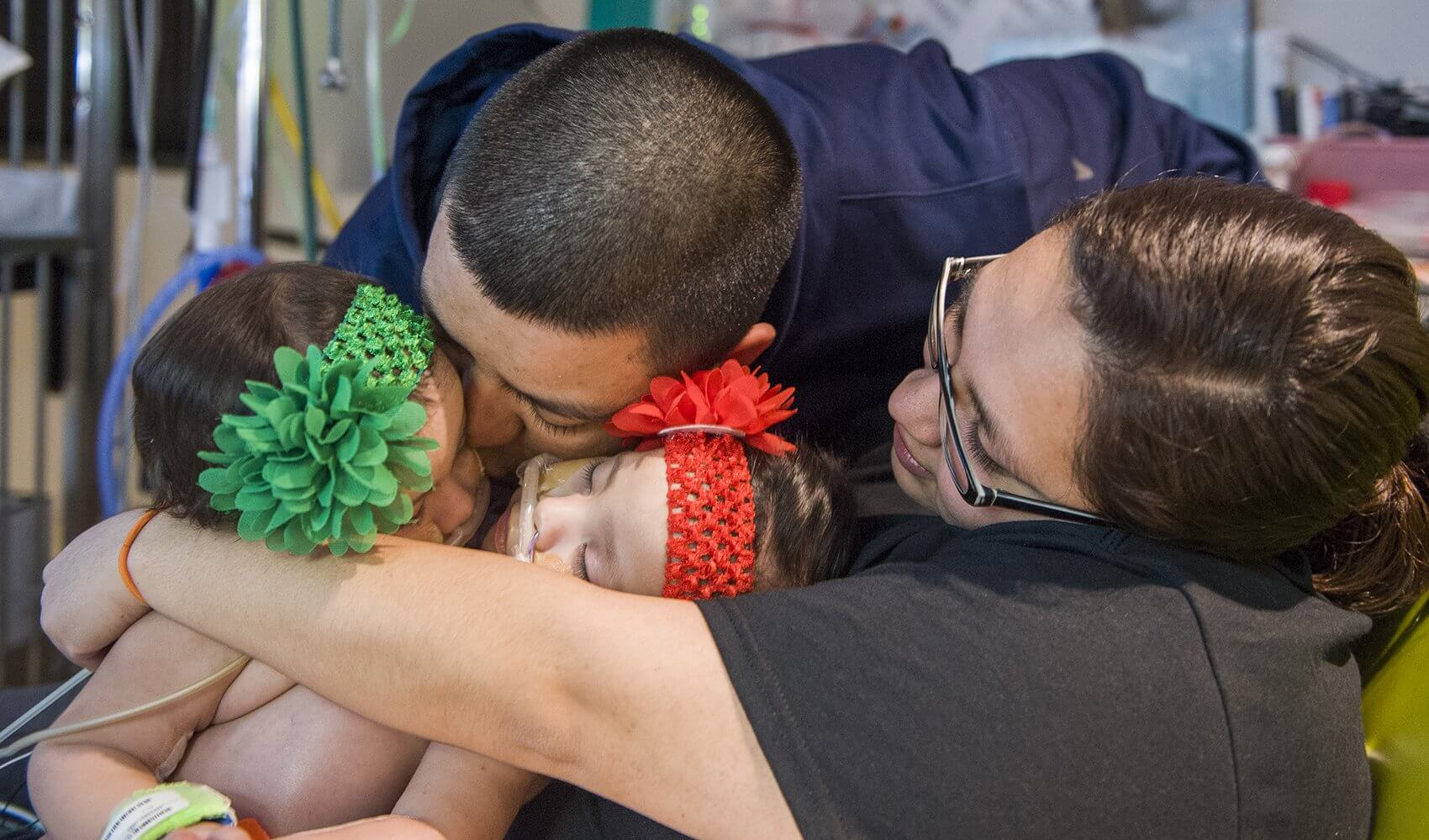 Mother Elysse Mata and father John Eric Mata embrace the twins before surgery. (Credit: Allen S. Kramer/Texas Children's Hospital)
