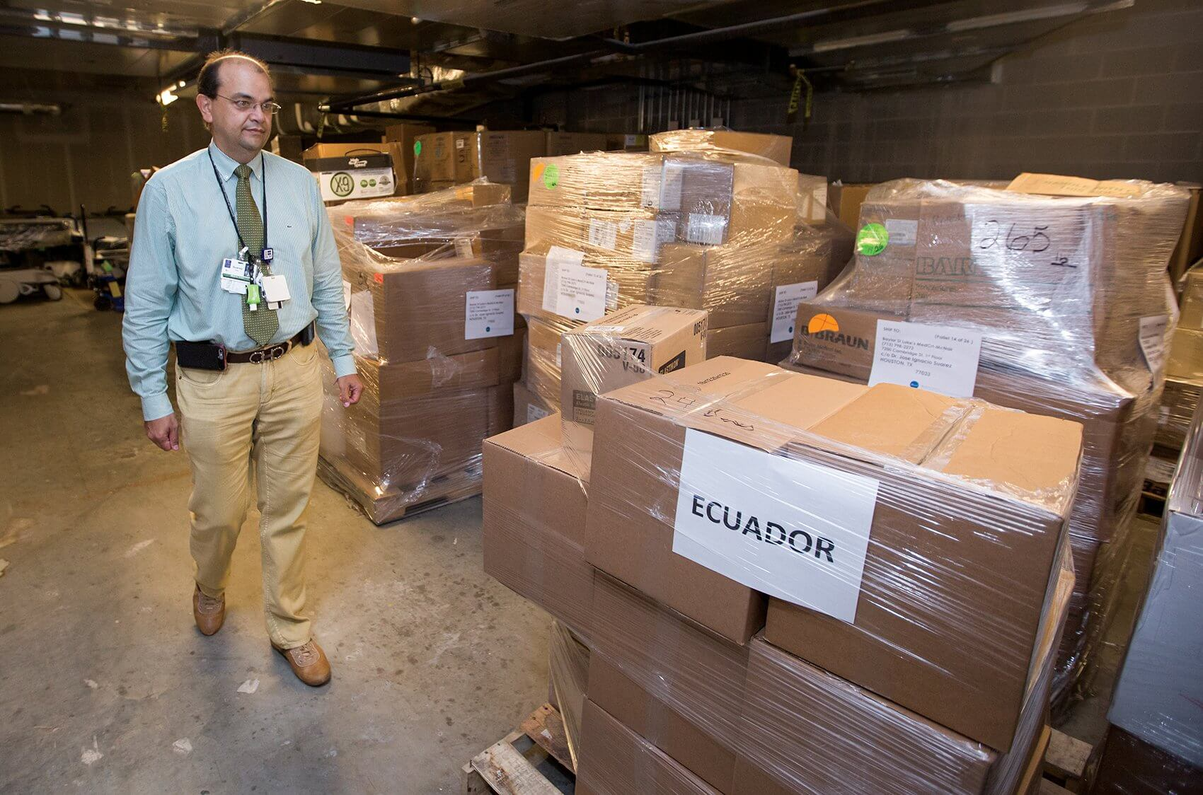 Jose Suarez, M.D., surveys the massive amount of medical supplies collected in response to the recent earthquake in Ecuador.